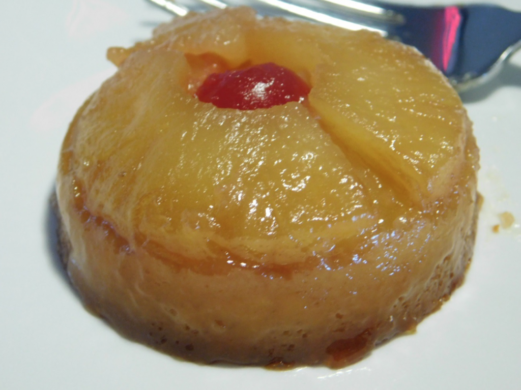 Mini pineapple upside down with a cherry in the middle