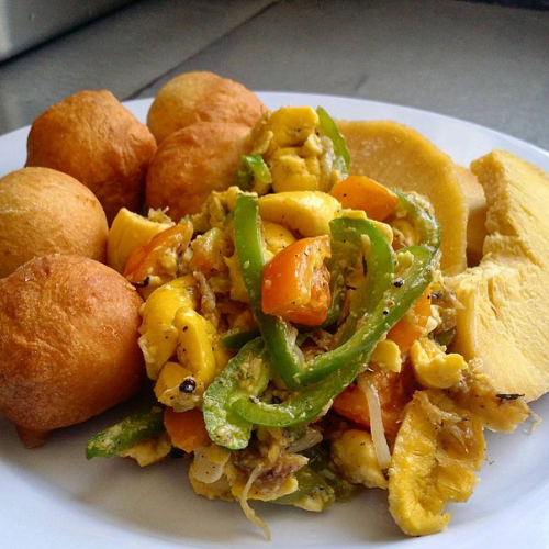a dish of ackee, saltfish, and roasted breadfruit