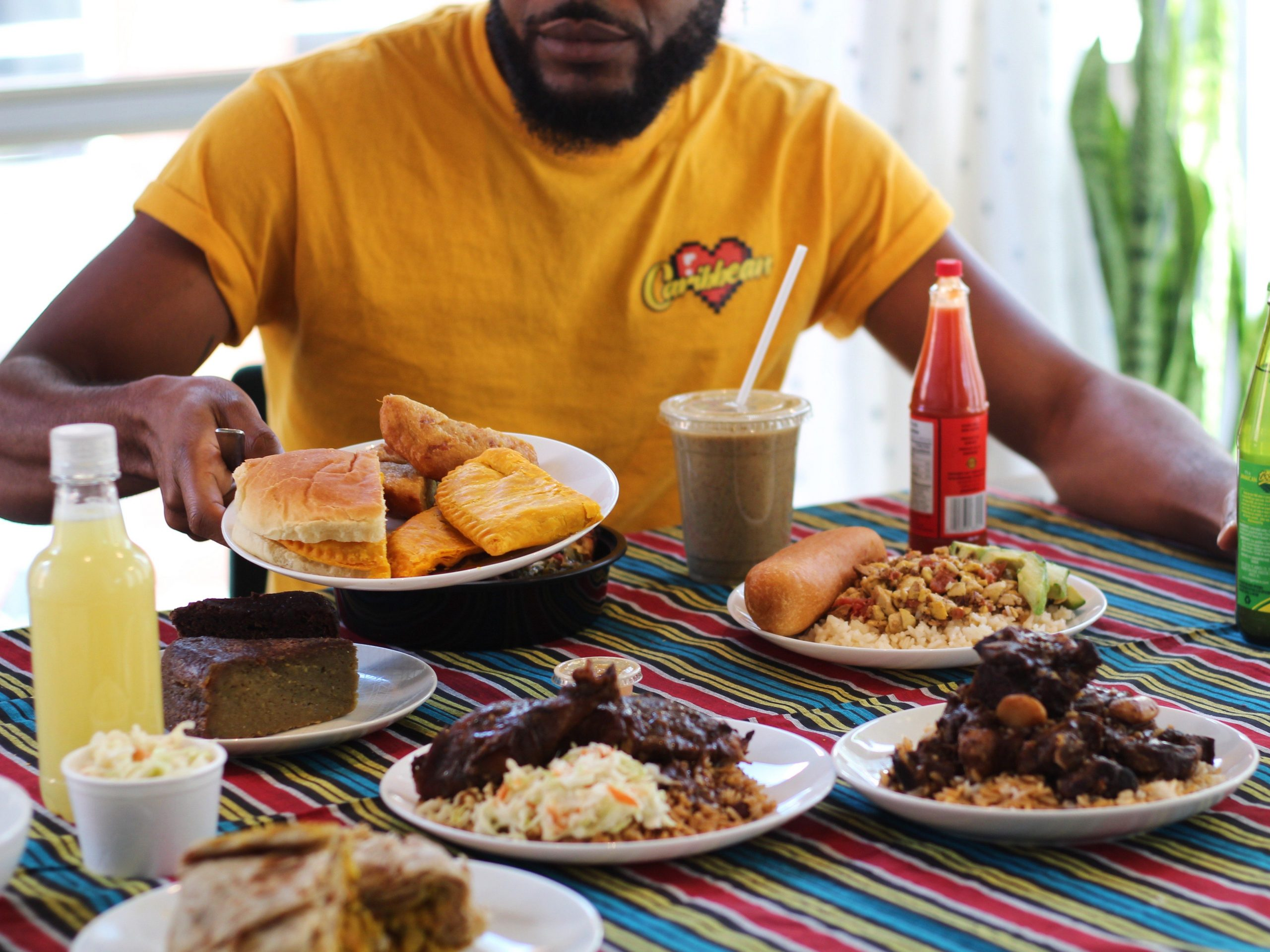 A spread of food from a Jamaican restaurant