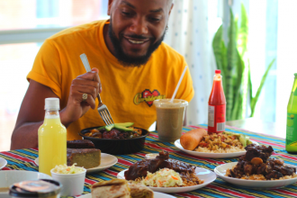 @seniorgumboy eating Jamaican food