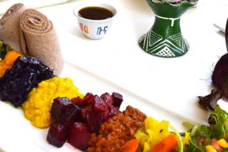 Ethiopian food pn a white tablecloth at Nunu Ethiopian Fusion