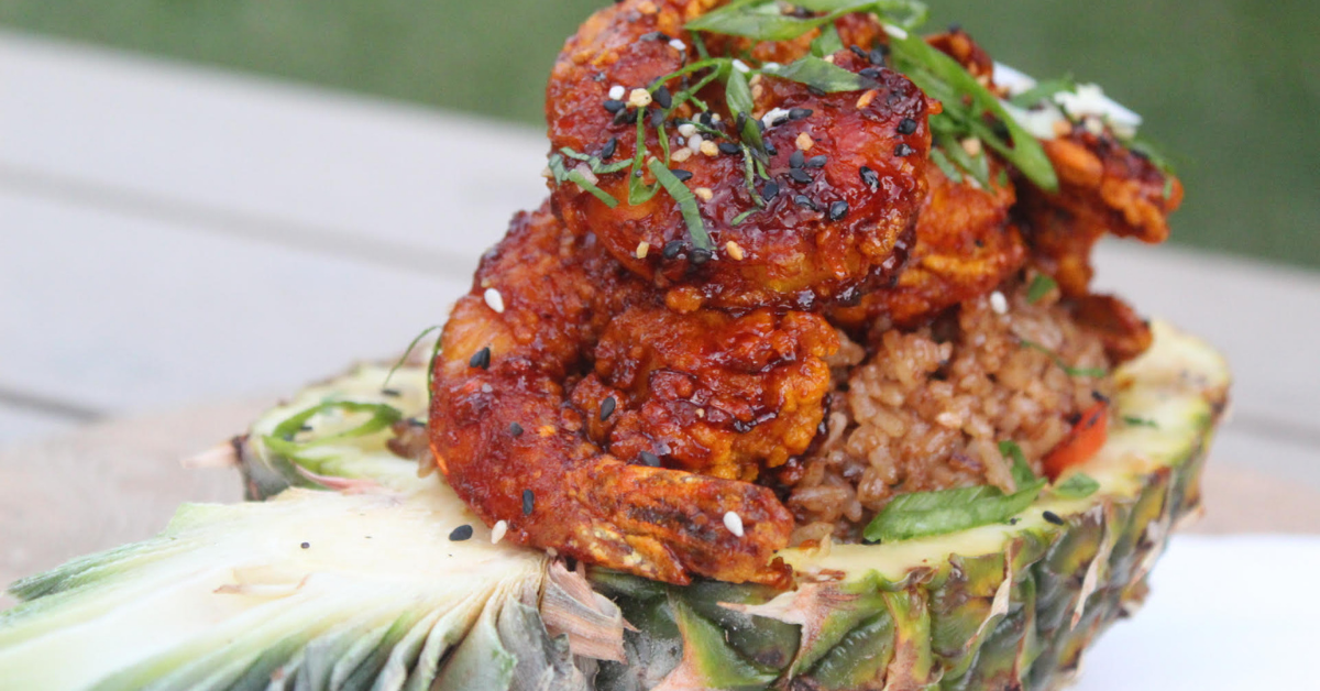 A hollowed pineapple filled with fried rice and seasoned shrimp from Dacyion Reid